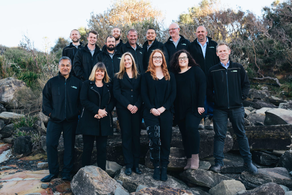 Fluid Plumbing Team posing in a group photo